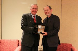 Interim dean Ron Owston receives his award from the Right Honourable Paul Martin, former Prime Minister of Canada