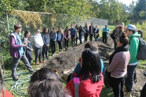 Doug Anderson teaches teacher candidates about the Indigenous agricultural earth mound