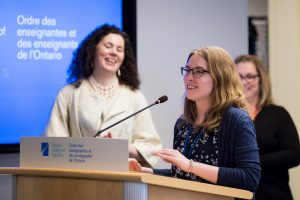 Photo of Kara Nagel at podium by Darren Goldstein/DSG Photo.
